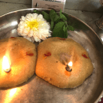 A traditional lamp lit for Lord Balaji (Venkateswara) - Lord of the Seven Hills This lamp is made with homemade rice flour and lit at home for the prosperity and Blessings from the Lord.