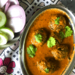 Lauki Methi Kofta Curry is a Low-fat Indian Curry (Gluten Free+vegan) made with bottlegourd and fenugreek leaves dumplings that are simmered in a spicy tomato base. Served with flatbreads and rice.