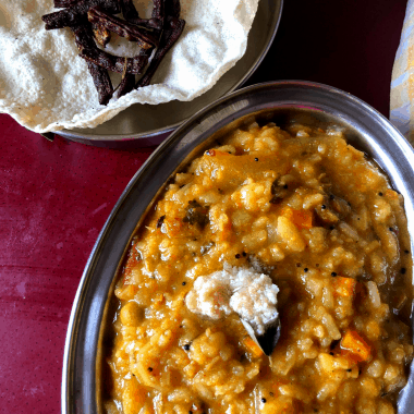 A Karnataka special One Pot Meal made with Lentils, veggies and flattened rice spiced with an aromatic powder.