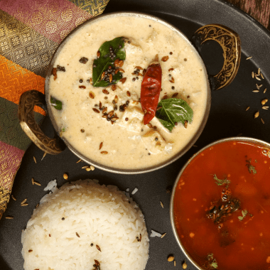 Vazhai Thandu Mor Kootu is a spiced curry made with yoghurt and tender banana stem. This is usually served with Sambhar and steamed rice.